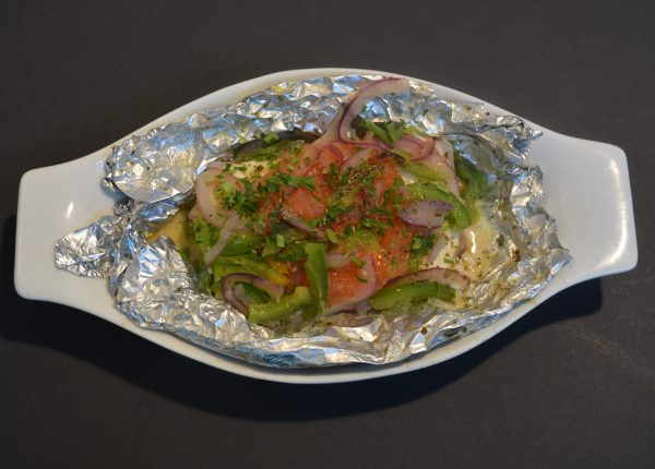 Grilled Feta Cheese in Foil with tomato, capsicum, oregano and extra virgin olive oil.