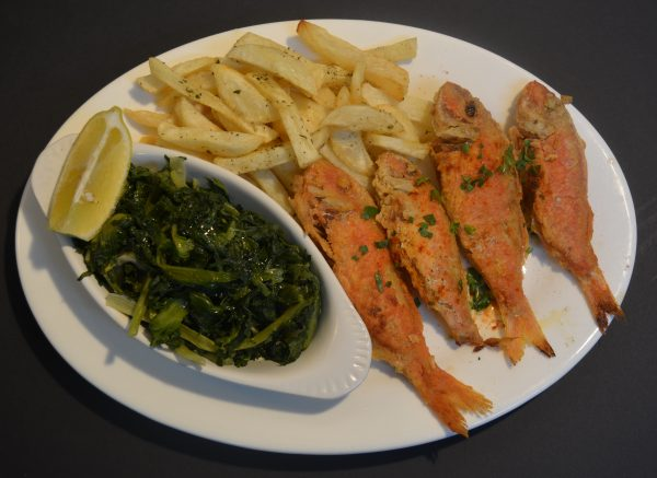 Fried Red Mullet (Barbouni) served with homemade chips and a portion of greens with olive oil.