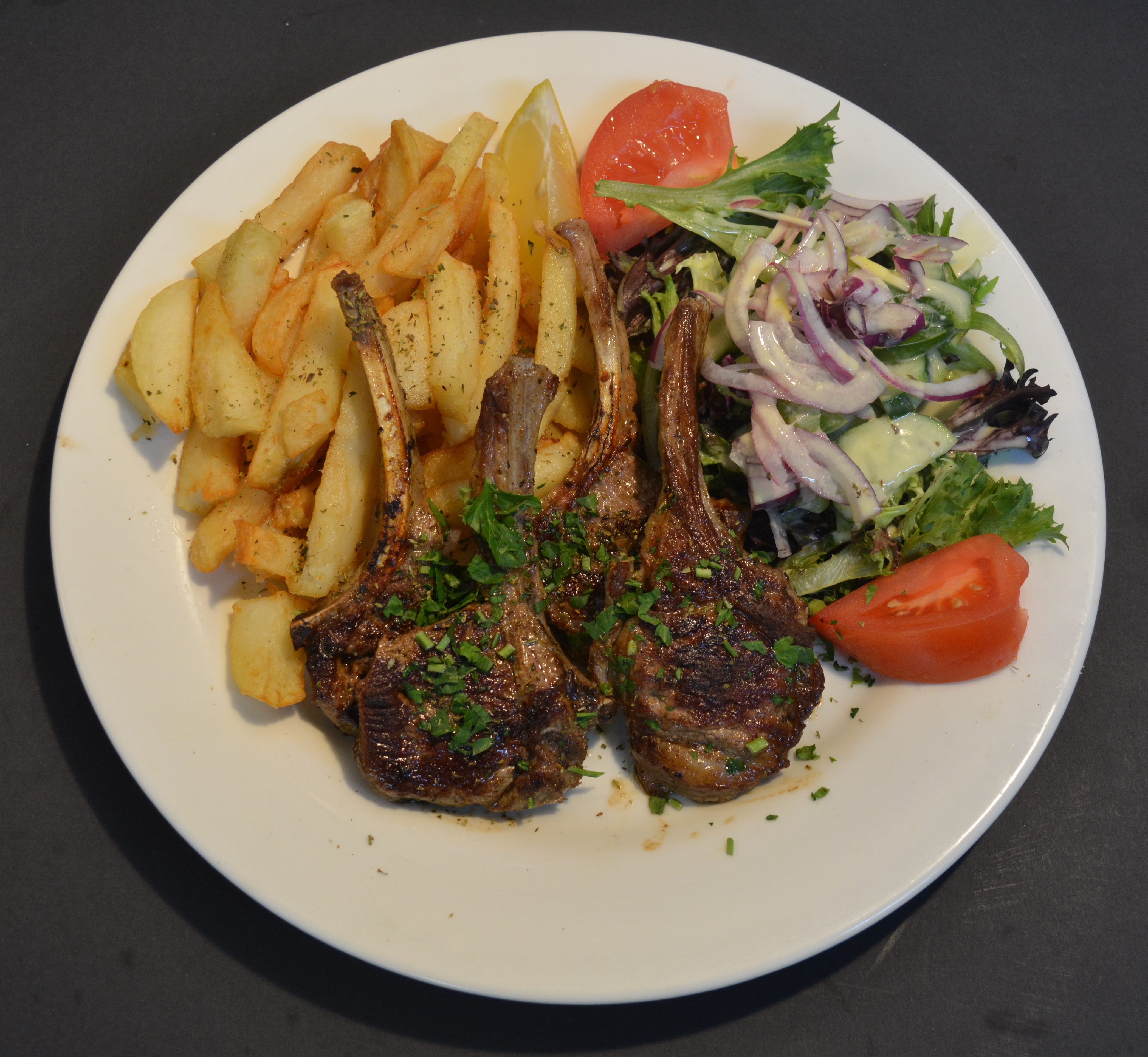 Grilled Lamb Cutlets served with homemade chips and salad or steamed veggies.