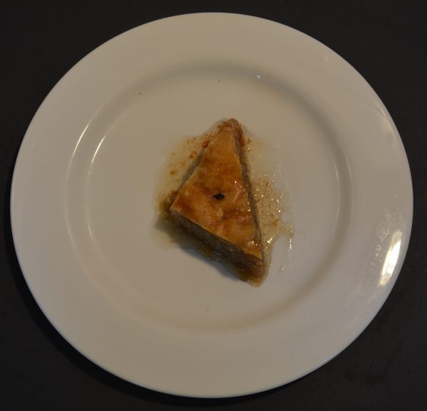 Baklava is a rich, sweet dessert pastry made of layers of filo filled with chopped nuts and sweetened and held together with syrup or honey.