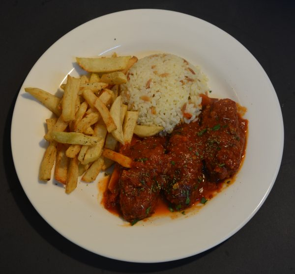 Soutzoukakia is a Greek dish of spicy oblong meatballs with cumin, cinnamon, and garlic