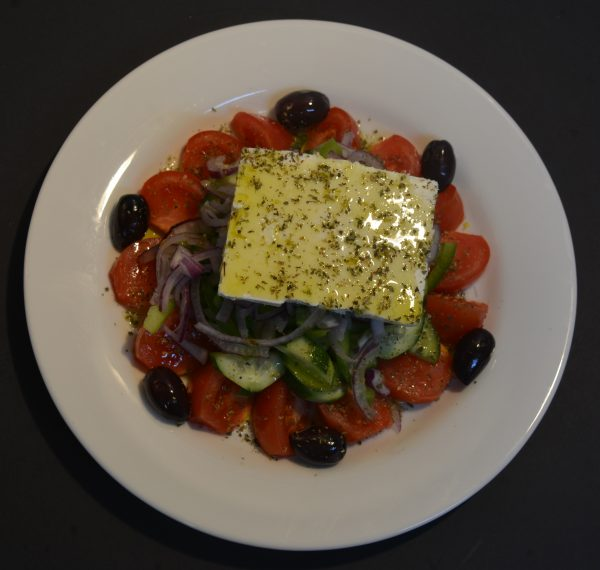 Large Greek Salad with tomato, cucumber, capsicum, onion, olives, feta cheese, oregano and extra virgin olive oil.