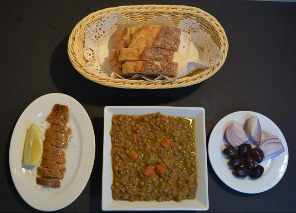 Lentils with herring, olives, onion, and bread