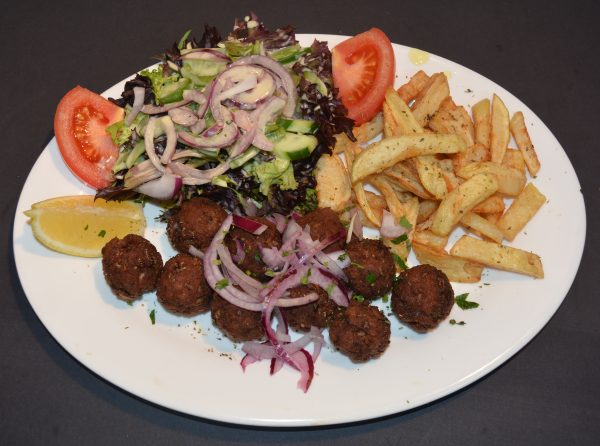 Meatballs, served with homemade chips and steamed veggies or salad.