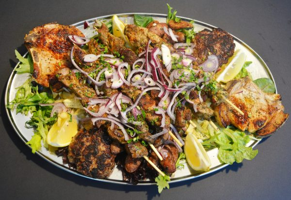 Meat Platter, served with chicken souvlakia, pork souvlakia, lamb souvlakia, sausages, pork chops, beef patties, and homemade chips.