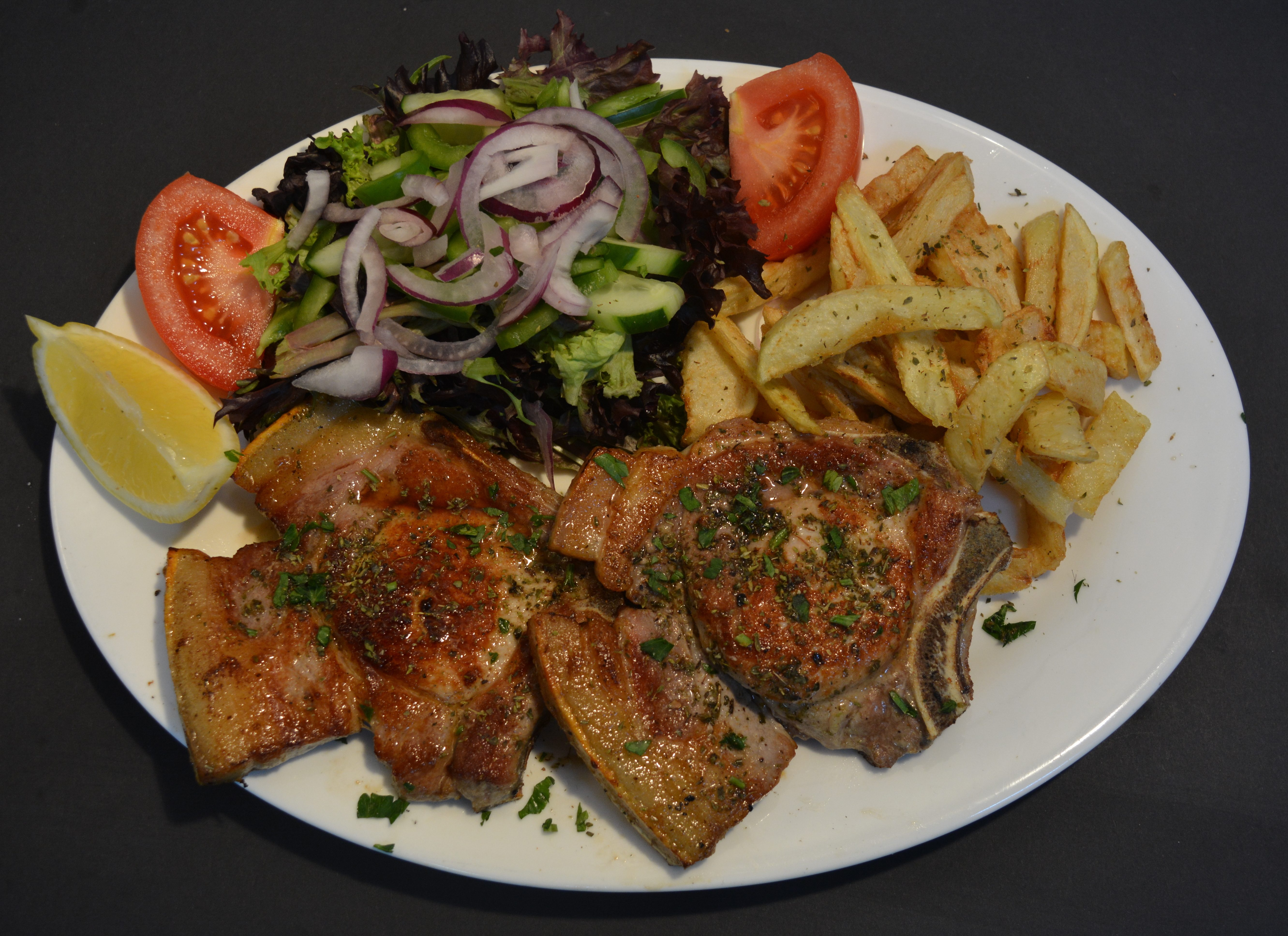 Pork Loin served with homemade chips and salad or steamed veggies.