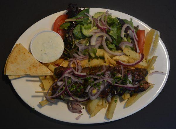 Pork Souvlaki served with homemade chips, tzatziki, pita bread and salad.