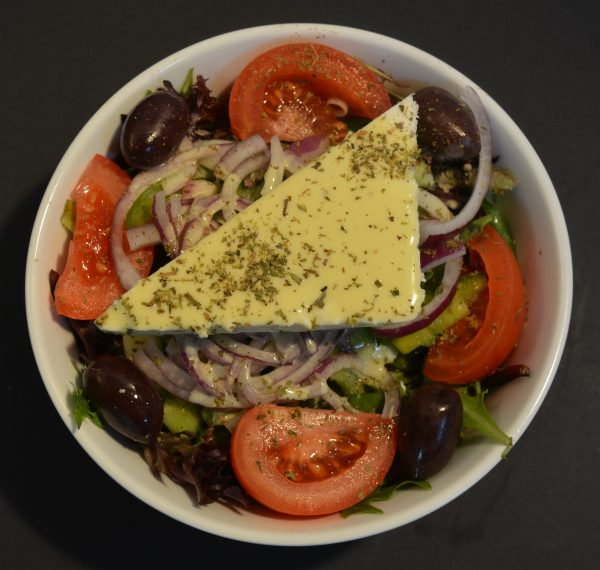 Regular Mixed Salad with lettuce, tomato, cucumber, capsicum, onion, olives, feta cheese, oregano and olive oil dressing.